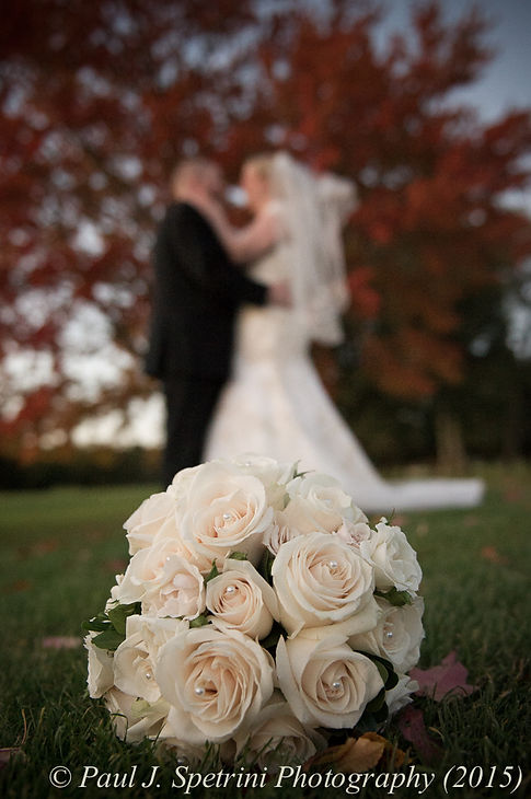Kerry and Adam pose for a formal photo at their fall wedding at Quidnessett Country Club in North Kingstown, Rhode Island on October 23rd, 2015.