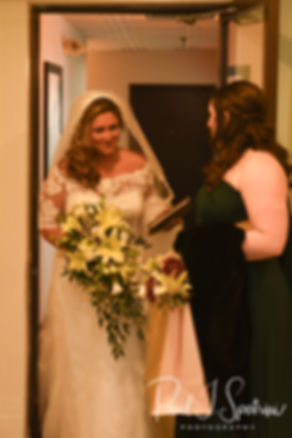 Cara gets ready to leave during her bridal prep session at the Aqua Blue Hotel in Narragansett, Rhode Island prior to her November 2018 wedding.