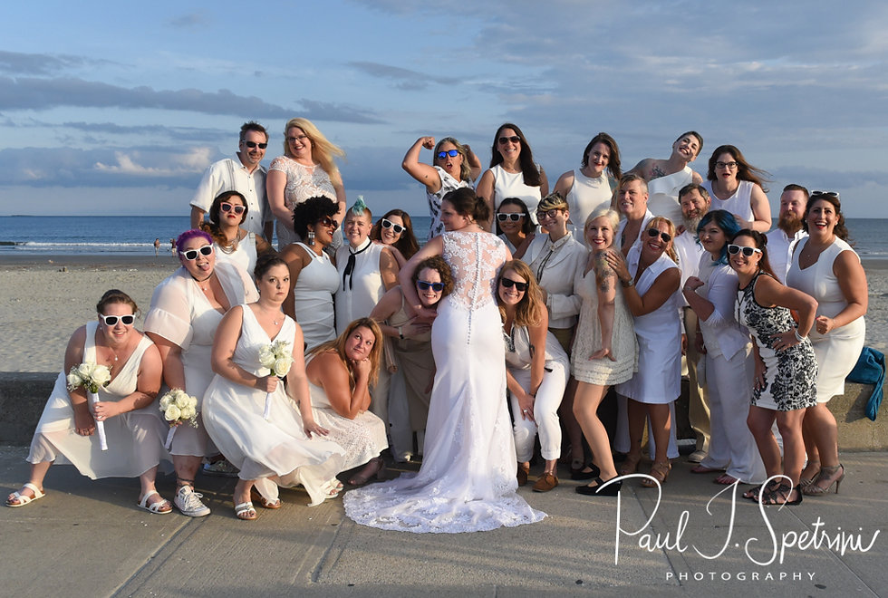 Selah poses for a photo with her friends from roller derby following her August 2018 wedding ceremony at The Rotunda Ballroom at Easton's Beach in Newport, Rhode Island.