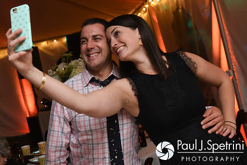 Guests pose for a selfie during JD and Brooke's October 2016 wedding reception at The Farm at SummitWynds in Jefferson, Massachusetts.