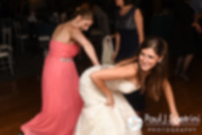 Marissa dances with her bridesmaid during her September 2016 wedding reception at the Aqua Blue Hotel in Narragansett, Rhode Island.