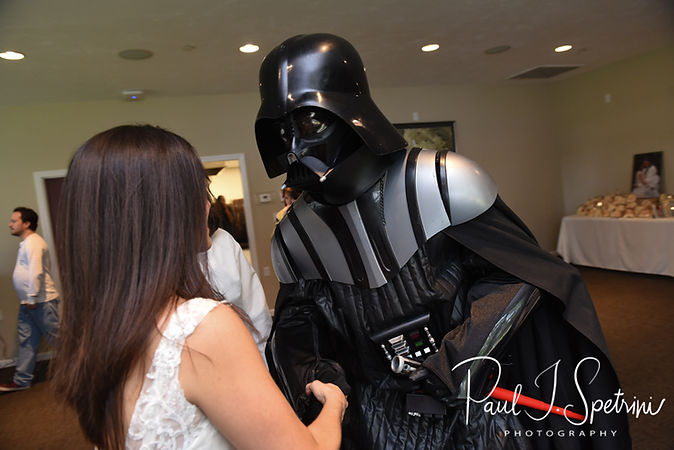 Amanda shakes Darth Vader's hand during her October 2018 wedding reception at Loon Pond Lodge in Lakeville, Massachusetts.