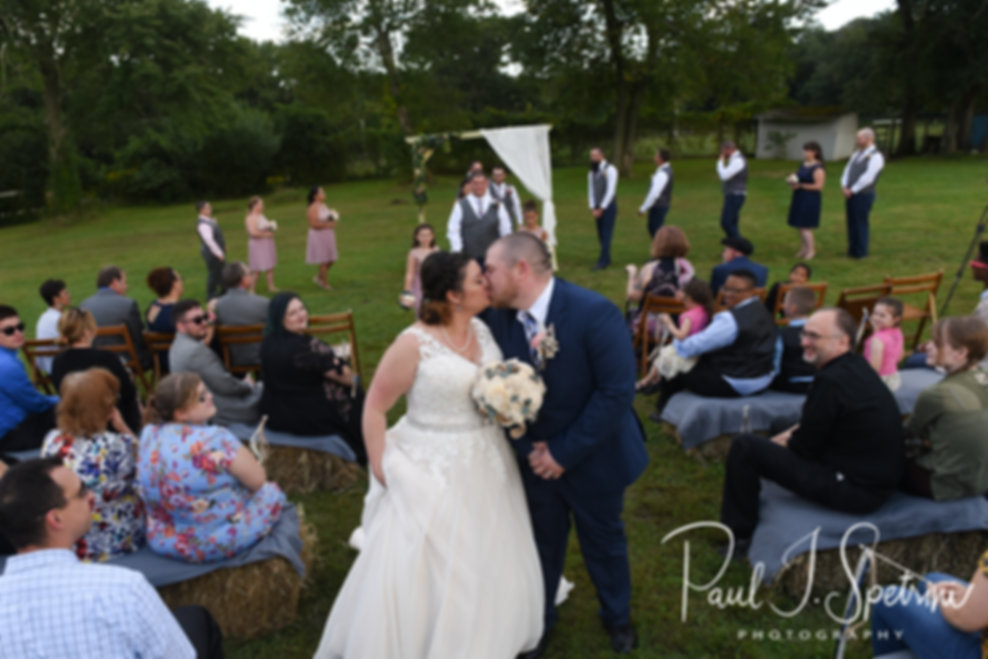 Adam & Ashley kiss at the end of their aisle following their September 2018 wedding ceremony at Stepping Stone Ranch in West Greenwich, Rhode Island.