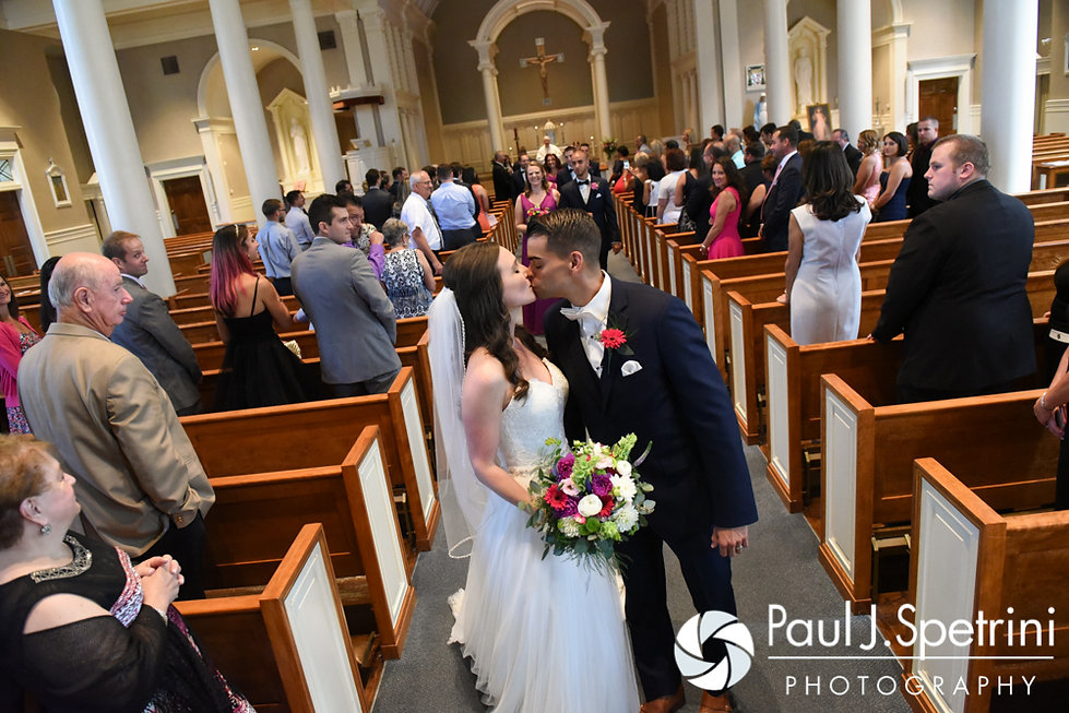 Alyssa and Alex share a kiss following their August 2016 wedding ceremony at Holy Name Church in Fall River, Massachusetts.