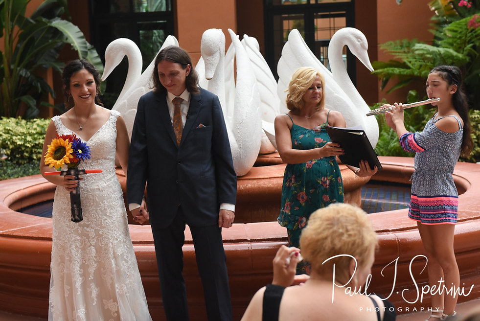 Amanda and Josh prepare to exit their October 2018 wedding ceremony at the Walt Disney World Swan & Dolphin Resort in Lake Buena Vista, Florida.