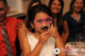 Maria's flower girl tries on prop glasses at Maria and Sebastian's March 2016 wedding reception at Falores Restaurant in Pawtucket, Rhode Island.