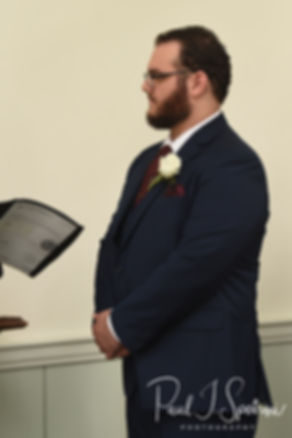 Rob looks at the officiant during his October 2018 wedding ceremony at South Ferry Church in Narragansett, Rhode Island.