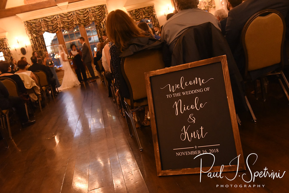 Nicole and Kurt hold hands during their November 2018 wedding ceremony at the Publick House Historic Inn in Sturbridge, Massachusetts.