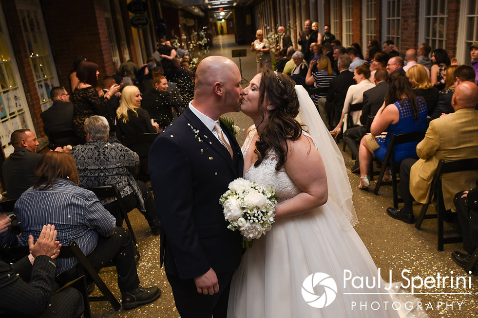 Meridith and Matthew stop for a kiss following their May 2017 wedding ceremony at the Hope Artiste Village in Pawtucket, Rhode Island.