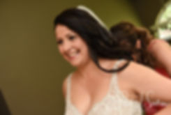 Stephanie has her dress zipped up prior to her June 2018 wedding ceremony at Foster Country Club in Foster, Rhode Island.