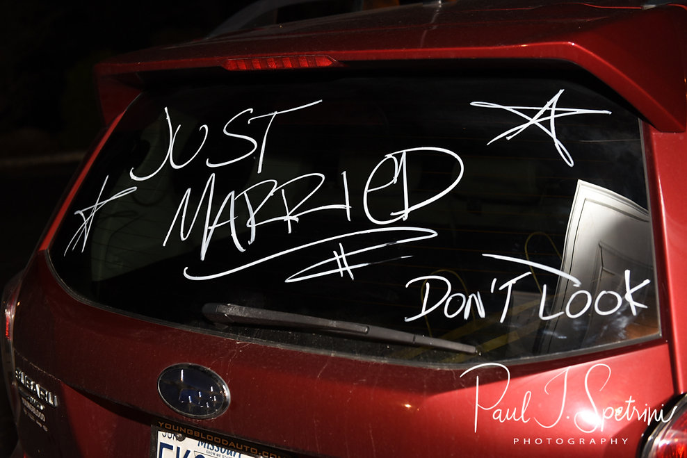 A car is written on following Nate & Kaytii's May 2018 wedding ceremony at Meadowbrook Inn in Charlestown, Rhode Island.