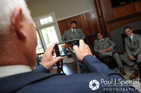 DJ's father takes a photo prior to his son's June 2016 wedding ceremony at St. Thomas More Church in Narragansett, Rhode Island.
