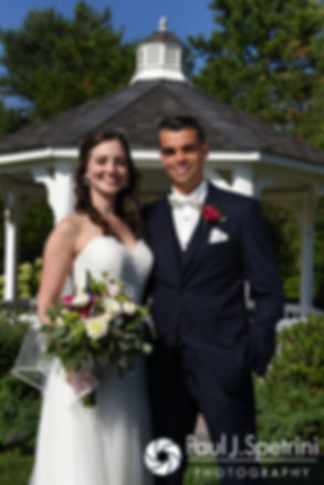 Alyssa and Alex smile for a formal photo prior to their August 2016 wedding reception at LeBaron Hills Country Club in Lakeville, Massachusetts.