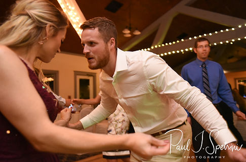 Guests dance during Lizzy & Gabe's September 2018 wedding reception at Crystal Lake Golf Club in Mapleville, Rhode Island.