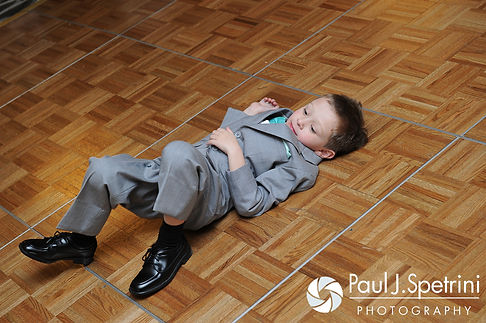 Angela's son sprawls out on the dance floor at his mom's spring 2016 Rhode Island wedding at the Hotel Viking in Newport, Rhode Island.