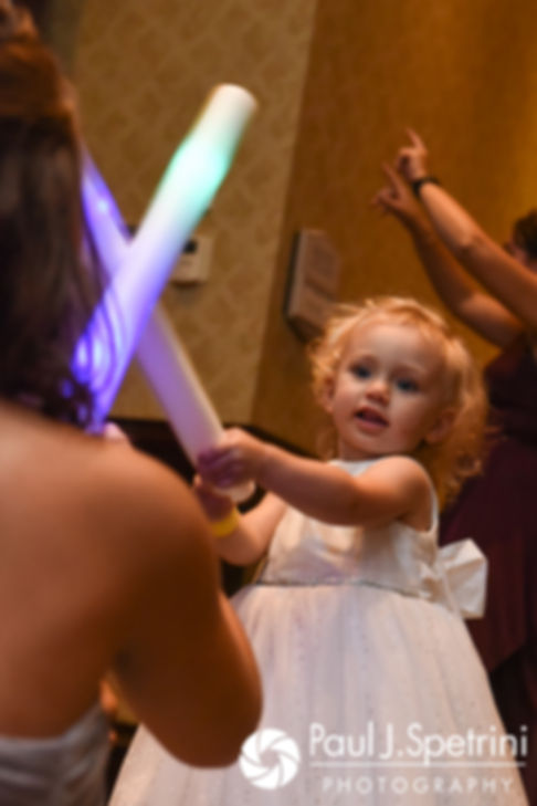 Guests play with light sticks during Dallas and Nicky's September 2017 wedding reception at the Crowne Plaza Hotel in Warwick, Rhode Island.