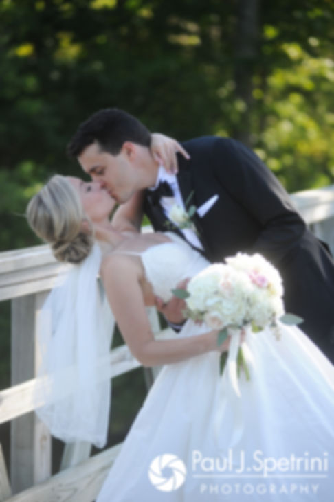 Laura and Laki kiss for a formal photo prior to their September 2017 wedding ceremony at Lake of Isles Golf Club in North Stonington, Connecticut.