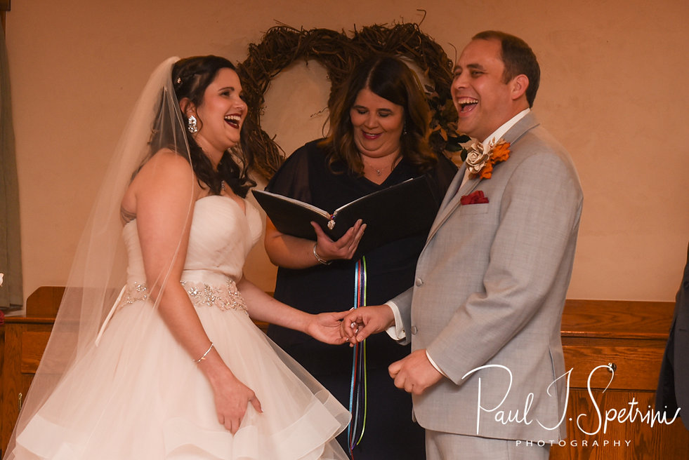 Rich and Makayla laugh during their October 2018 wedding ceremony at Zukas Hilltop Barn in Spencer, Massachusetts.