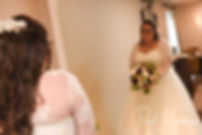 Katie looks in the mirror prior to her October 2018 wedding ceremony at The Villa at Ridder Country Club in East Bridgewater, Massachusetts.