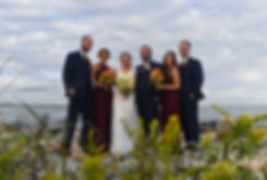 Rob & Allie pose for photo with their wedding party prior to their October 2018 wedding ceremony at South Ferry Church in Narragansett, Rhode Island.