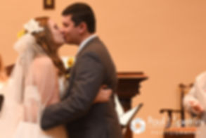 Kristin and Chris share their first kiss during their October 2016 wedding ceremony at Exeter Congregational Church in Exeter, New Hampshire.