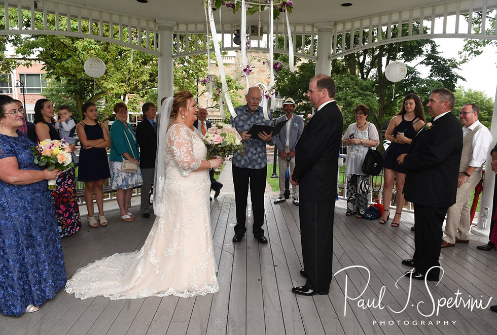 Patti and Bob look at each other during their August 2018 wedding ceremony at the Walter J. Dempsey Memorial Bandstand in Norwood, Massachusetts.