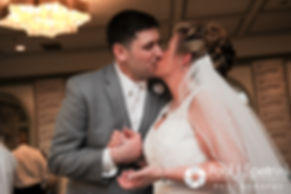 Angela and Shawn share a kiss at their spring 2016 Rhode Island wedding at the Hotel Viking in Newport, Rhode Island.