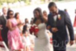 Jimmy and Saken walk down the aisle during their July 2018 wedding ceremony at Lake Pearl in Wrentham, Massachusetts.