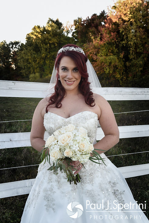Brooke smiles for a formal photo prior to her October 2016 wedding reception at The Farm at SummitWynds in Jefferson, Massachusetts.