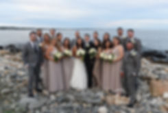 Nicole and Dan pose for a photo with their wedding party following their September 2018 wedding ceremony at The Towers in Narragansett, Rhode Island.