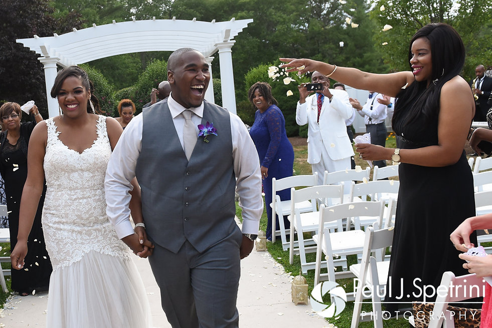 Kemi and Warren laugh following their August 2016 wedding reception at the Villa at Riddler Country Club in East Bridgewater, Massachusetts.