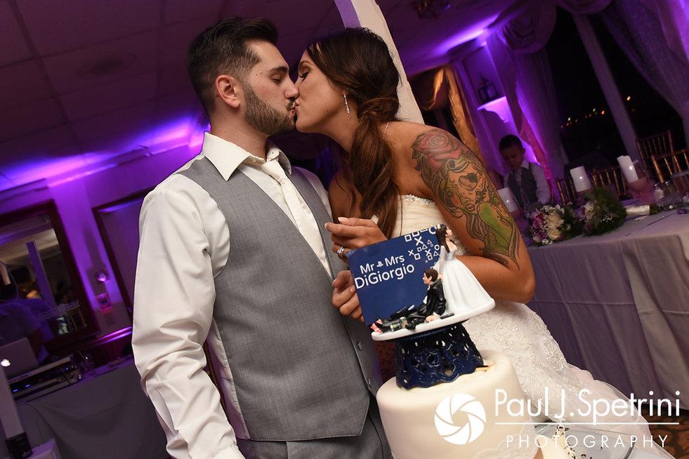 Stacey and John kiss after cutting their wedding cake during their September 2017 wedding reception in Warren, Rhode Island.