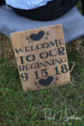 A sign is on display during Adam & Ashley's September 2018 wedding ceremony at Stepping Stone Ranch in West Greenwich, Rhode Island.