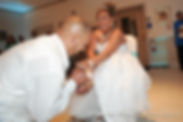 Joe Andrade takes the garter off his wife Jean.
