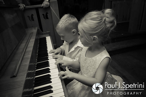 Children play a piano during Kim and Matt's August 2016 wedding at Whispering Pines Conference Center in West Greenwich, Rhode Island.
