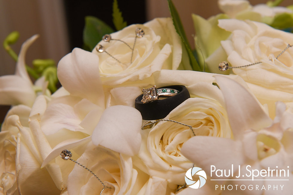 A look at Kelly and Brian's wedding rings and Kelly's bouquet, on display during their November 2016 wedding reception at the Bay Pointe Club in Buzzards Bay, Massachusetts.