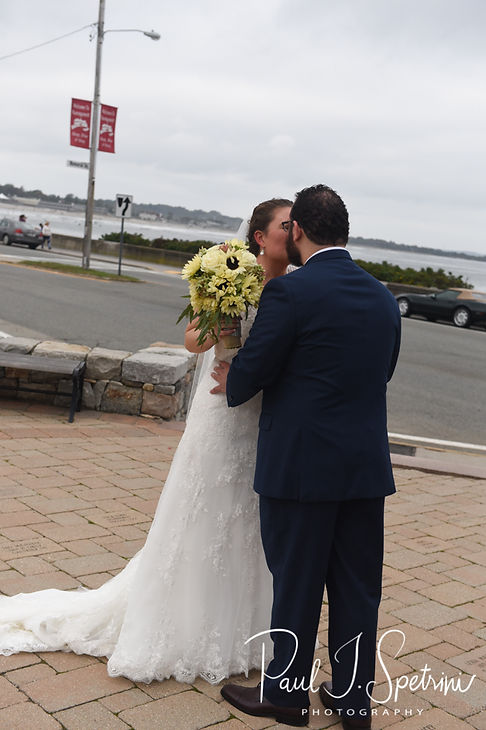 Rob and Allie kiss prior to their October 2018 wedding ceremony at South Ferry Church in Narragansett, Rhode Island.
