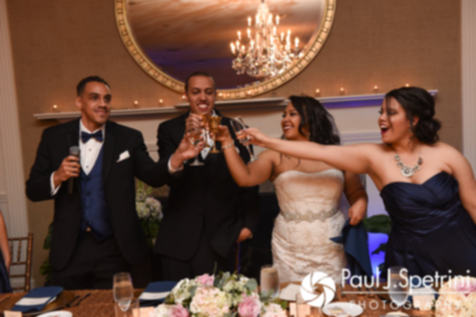 Arten and Stephany toast with their maid of honor and best man during their September 2017 wedding reception at Wannamoisett Country Club in Rumford, Rhode Island.