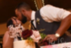 Lizzy & Gabe kiss after cutting their wedding cake during their September 2018 wedding reception at Crystal Lake Golf Club in Mapleville, Rhode Island.