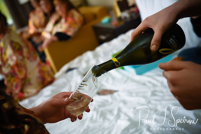 Katie has a drink poured during bridal prep prior to her October 2018 wedding ceremony at The Villa at Ridder Country Club in East Bridgewater, Massachusetts.