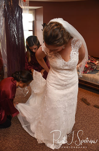 Allie gets her dress zipped up prior to her October 2018 wedding ceremony at South Ferry Church in Narragansett, Rhode Island.