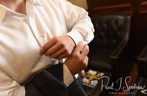 Brian adjusts his shirt cuffs prior to his September 2018 wedding ceremony, at Gents Barbershop and Spa in Cranston, Rhode Island.