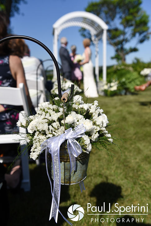 A look at the flowers in the aisle for Bob and Debbie's June 2016 wedding in Barrington, Rhode Island.