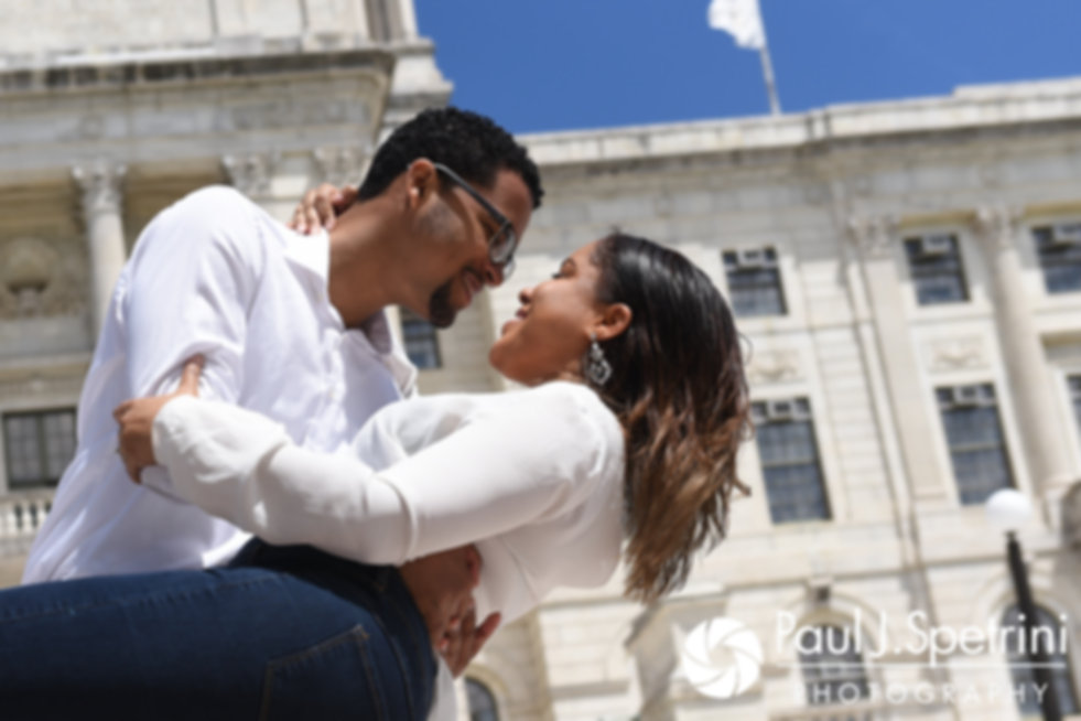 Lucelene and Luis kiss for a photo at the Rhode Island Statehouse in Providence, Rhode Island during their May 2017 engagement shoot.