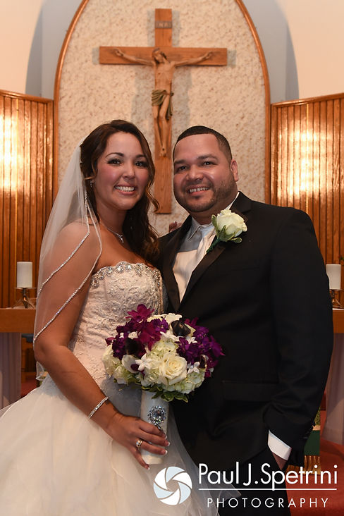 Stephanie and Henry smile for a formal photo following their October 2016 wedding ceremony at the Historic St. Joseph Church in Cumberland, Rhode Island.