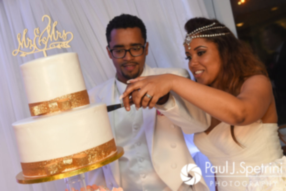 Lucelene and Luis cut the cake during their June 2017 wedding reception at Al's Waterfront Restaurant in East Providence, Rhode Island.