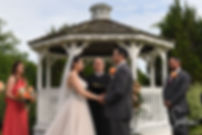 Jacob and Stephanie listen to their officiant during their June 2018 wedding ceremony at Foster Country Club in Foster, Rhode Island.