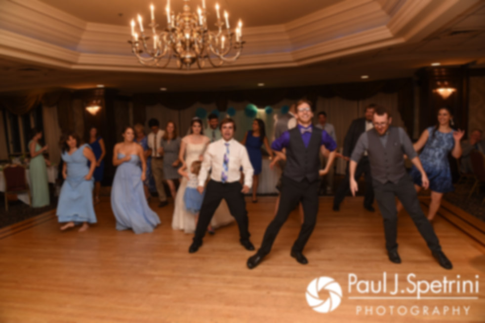 Guests dance during Neil and Gianna's July 2017 wedding reception at Quidnessett Country Club in North Kingstown, Rhode Island.