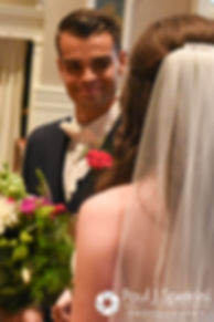 Alex looks at Alyssa during their August 2016 wedding ceremony at Holy Name Church in Fall River, Massachusetts.