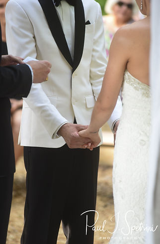Kendra and Joe hold hands during their May 2018 wedding ceremony at Crystal Lake Golf Club in Mapleville, Rhode Island.